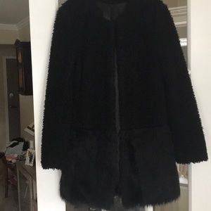 Faux fur coat for day or evening. Fully lined